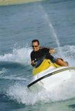 Un hombre en un esquí del jet Imagen de archivo libre de regalías