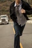 Un hombre en un lazo Sprinting fotografía de archivo libre de regalías