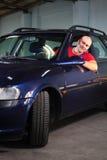 Un hombre en vehículo Imagen de archivo libre de regalías