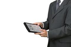 Un hombre está sosteniendo una tableta Fotos de archivo