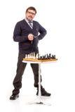 Un hombre hermoso en un traje y vidrios, con un tubo para fumar Imagen de archivo libre de regalías