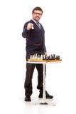 Un hombre hermoso en un traje y vidrios, con un tubo para fumar Foto de archivo libre de regalías