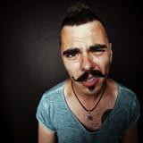 Un hombre joven con un bigote después del partido Fotos de archivo libres de regalías