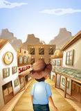 Un hombre joven con un sombrero que va a la barra de salón Foto de archivo libre de regalías
