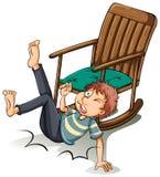 Un hombre que se cayó apagado de la silla Imagen de archivo libre de regalías