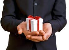 Un homme avec un cadeau Image libre de droits
