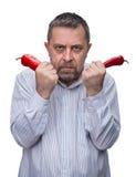 Un homme avec un poivron rouge Photo stock