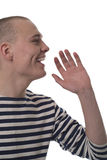 Un homme chauve dans le gilet rayé Photo stock