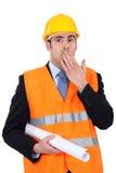 Un homme d'affaires étonné de construction Photo stock