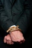 Un homme d'affaires avec ses mains a attaché Images libres de droits