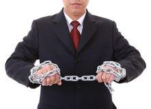 Un homme d'affaires pour faire des maillons d'une chaîne de traction Image stock
