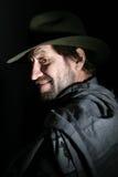 Un homme dans un chapeau Photos stock