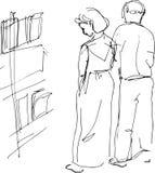 Un homme et une femme sur une exposition des peintures Photographie stock libre de droits