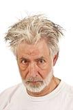 Un homme plus âgé montrant la colère ou le soupçon Photographie stock libre de droits