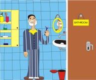 Un homme rasant dans la salle de bains Photos stock