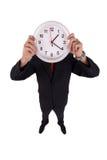 Un homme retient une horloge Photo libre de droits