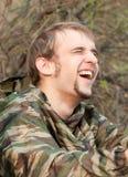 Un homme riant Photos stock