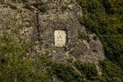 Un'icona cristiana è in una roccia Fotografia Stock