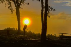 Un-identified photographer shooting photo of beautiful sunrise v. Iew in national park of Thailand Stock Photography