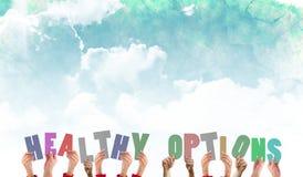 Un'immagine composita delle mani che ostacolano le opzioni sane fotografie stock libere da diritti