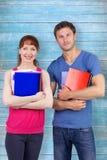 Un'immagine composita di due studenti entrambe con i blocchi note Fotografie Stock