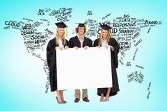 Un'immagine composita di tre studenti in abito laureato che tiene un segno in bianco Fotografia Stock Libera da Diritti