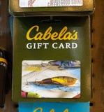 Un'immagine della carta di regalo pesca-di tema di un Cabela, idea di festa del papà fotografie stock