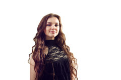 Un'immagine di giovane bella donna in un vestito nero che posa ove Immagine Stock Libera da Diritti
