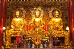 Un'immagine di tre Buddha Fotografie Stock