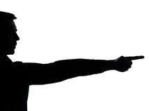 Un indicare della siluetta della mano dell'uomo di affari Immagini Stock