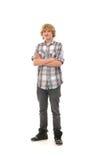 Un individuo adolescente feliz que presenta en ropa moderna Imágenes de archivo libres de regalías
