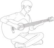 Un individuo que toca la guitarra Imagen de archivo libre de regalías