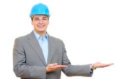 Un ingénieur avec le casque antichoc bleu Photographie stock