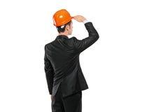 Un ingénieur de construction dans un regard de procès Photographie stock