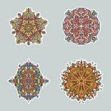 Un insieme astratto della mandala di scarabocchio di un'illustrazione di quattro vettori Immagini Stock