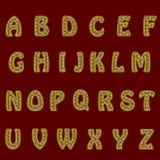 Un insieme completo delle lettere dell'oro con la maglia del pizzo I bordi delle lettere sono fatti con cavo sottile La fonte è i Fotografie Stock Libere da Diritti