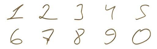 Un insieme dei numeri da un cavo dorato Fotografia Stock