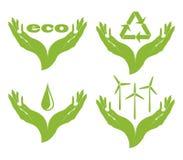 Un insieme dei simboli di eco in mani femminili. Fotografie Stock Libere da Diritti