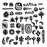 Un insieme dei simboli tribali primitivi Fotografia Stock