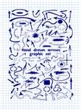 Un insieme delle frecce grafiche disegnate a mano sullo strato del taccuino Fotografia Stock Libera da Diritti