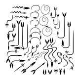 Un insieme delle frecce nello stile calligrafico d'annata fotografia stock libera da diritti
