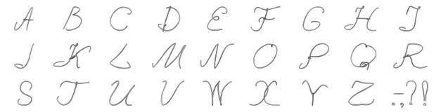 Un insieme delle lettere da un cavo dallo spazzolato da-metall Fotografia Stock
