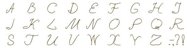 Un insieme delle lettere da un cavo dorato Immagine Stock Libera da Diritti