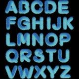 Un insieme delle lettere dell'alfabeto dipinto blu con un colore blu di pendenza, l'effetto è lanuginoso, morbido Stampando su un illustrazione di stock