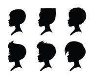 Un insieme delle siluette delle ragazze con i brevi tagli di capelli Fotografia Stock Libera da Diritti