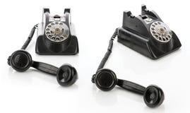 Un insieme di due telefoni d'annata isolati su un fondo bianco Fotografia Stock