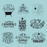 Un insieme di 9 iscrizioni di Natale con l'iscrizione della notte con lettere santa della O Gioia, speranza, amore, pace Saluti d illustrazione di stock