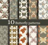 Un insieme di 10 modelli di farfalla senza cuciture Fotografia Stock