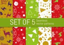 Un insieme di 5 modelli senza cuciture del nuovo anno e di Natale Per il modello della carta da imballaggio Fotografia Stock Libera da Diritti