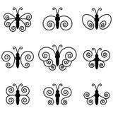 Un insieme di nove farfalle per progettazione Immagini Stock Libere da Diritti